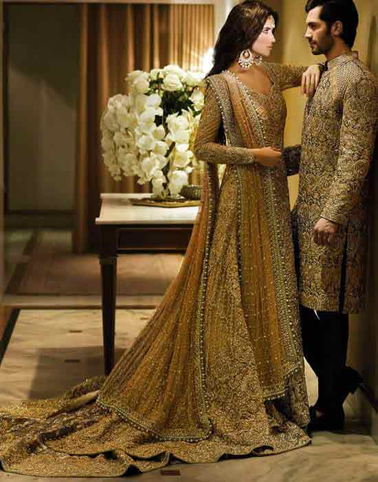 Bridal in mustard and golden long tail maxi shirt with lehnga and groom in matching sherwani with pajama latest indian and pakistani wedding matching dress combinations for bride and groom 2017