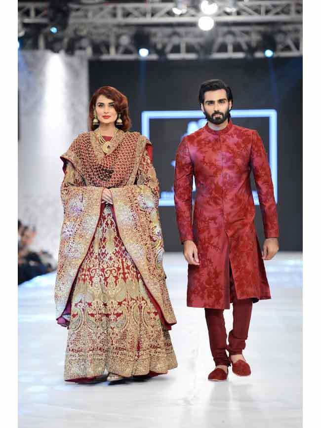 Bridal in red and maroon embroidered lehnga choli with dupatta and groom in matching maroon sherwani with pajama latest indian and pakistani wedding matching dress combinations for bride and groom 2017