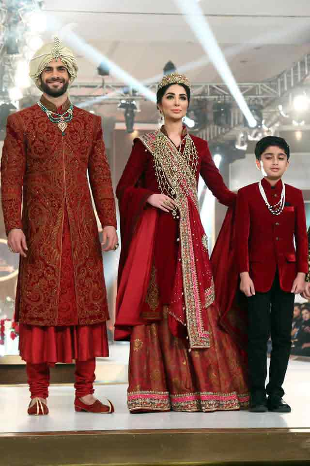 Bridal in traditional maroon long shirt with sharara and groom in matching sherwani with pajama trouser latest indian and pakistani wedding matching dress combinations for bride and groom 2017