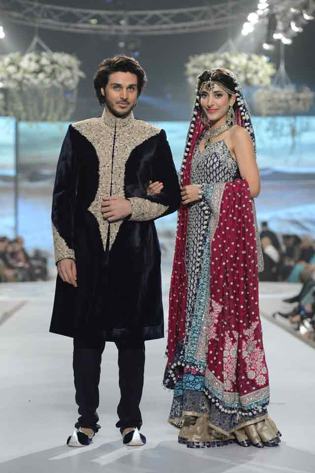 Bridal in grey black long shirt with sharara and red dupatta and groom in embroidered black matching sherwani with pajama or trouser latest indian and pakistani wedding matching dress combinations for bride and groom 2017
