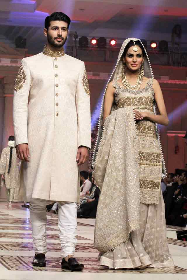 Bridal in Embroidered ash grey long shirt and sharara or gharara and groom in matching white sherwani with white trouser or pajama latest indian and pakistani wedding matching dress combinations for bride and groom 2017