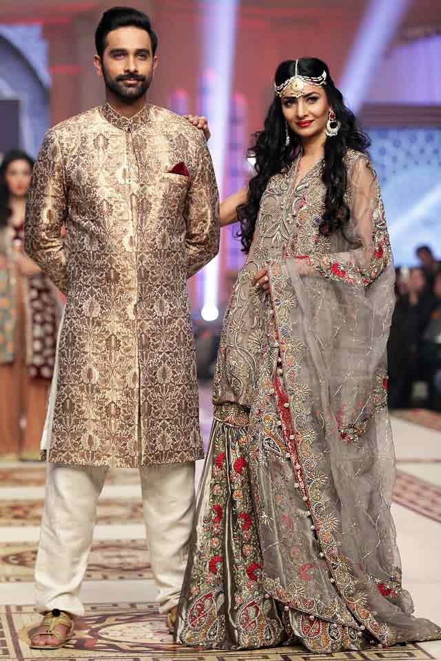 Bridal in classy ash grey dress with dupatta and groom in matching short sherwani with white pajama or trouser latest indian and pakistani wedding matching dress combinations for bride and groom 2017