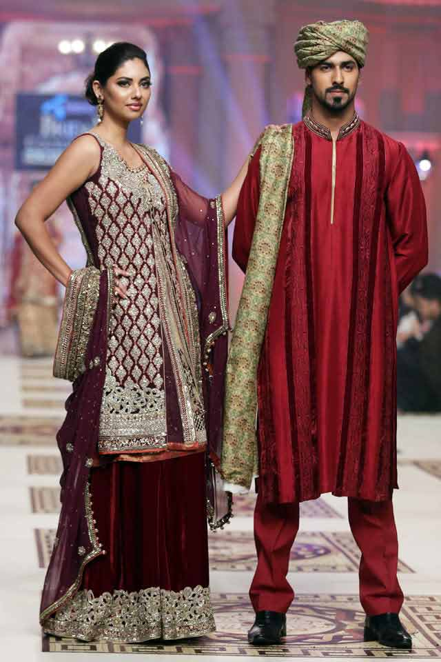 bridal in traditional reddish maroon embroidered lehnga with long shirt and groom in matching maroon kurta with dupatta latest indian and pakistani wedding matching dress combinations for bride and groom 2017