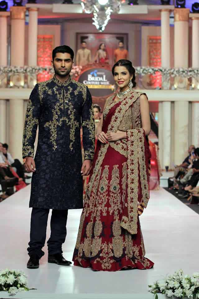 bridal in traditional maroon red lehnga choli with skin embroidery and groom in dark blue embroidered kurta latest indian and pakistani wedding matching dress combinations for bride and groom 2017
