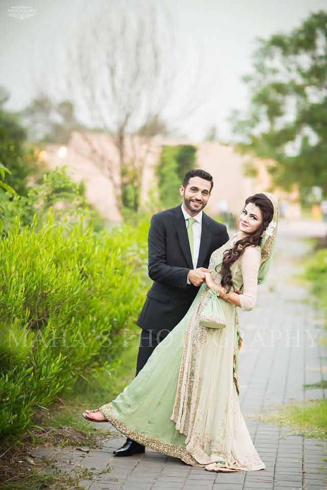 bride in light green bridal dress and dupatta and groom in pant coat with matching light green tie latest indian and pakistani wedding matching dress combinations for bride and groom 2017