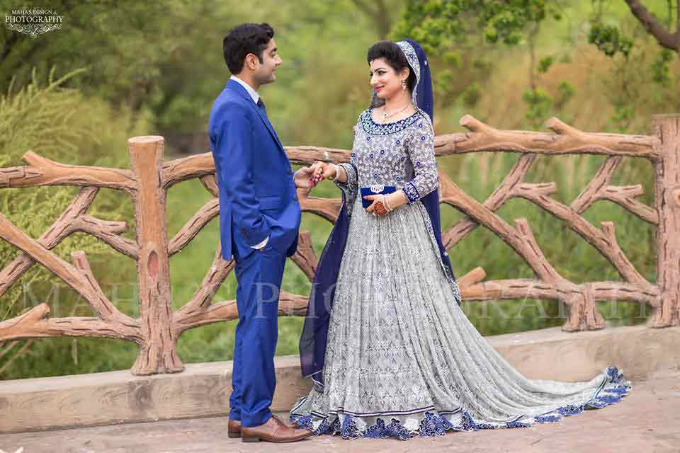 bridal in grey long tail frock with blue dupatta and groom in blue matching pant coat latest indian and pakistani wedding matching dress combinations for bride and groom 2017