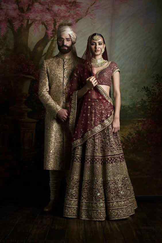 Bridal in maroon lehnga choli with dupatta and groom in cream sherwani latest indian and pakistani wedding matching dress combinations for bride and groom 2017