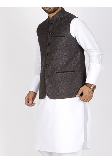 men black waistcoat with white kurta men eid kurta shalwar kameez and waistcoat dress designs 2017 by Junaid Jamshed