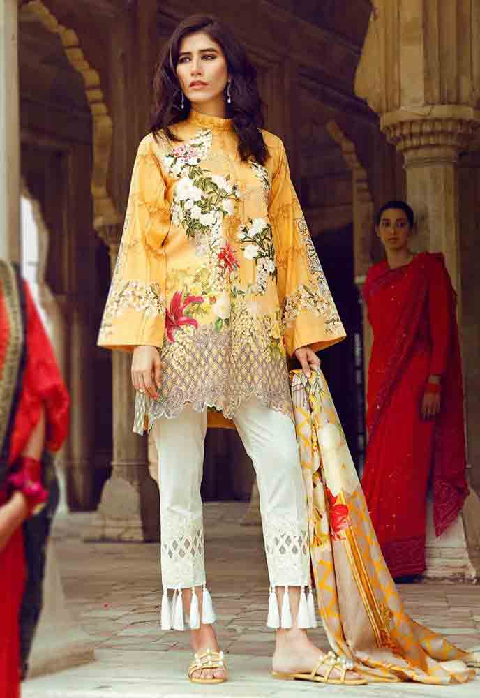 Cross Stitch yellow kurti with white capri new eid dress designs for girls in Pakistan 2017