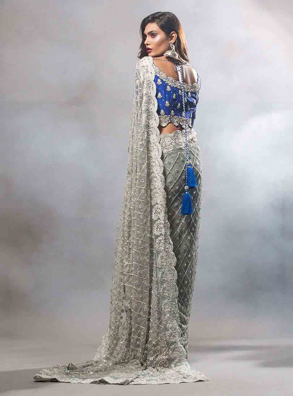 Pakistani saree designs in blue and grey colors for wedding brides