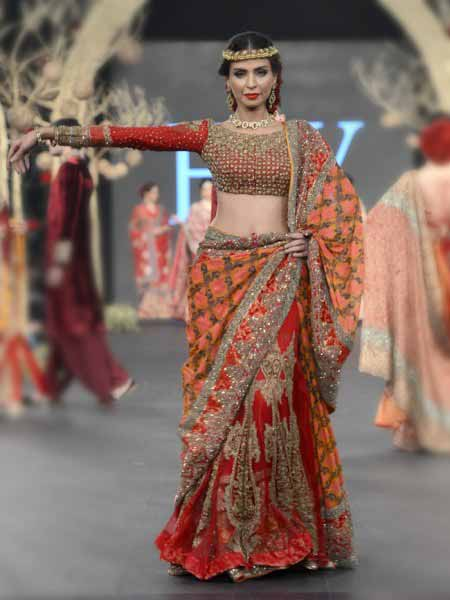 Pakistani saree designs in orange and red colors for wedding brides
