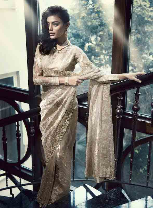 Pakistani saree designs in golden colors for wedding brides