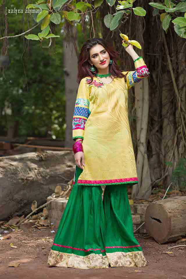 Latest yellow short shirt with green sharara or gharara by by Zahra Ahmad Eid dresses for girls in Pakistan