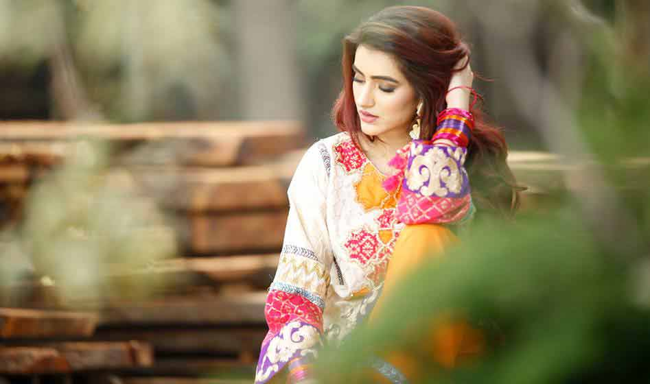 Best white and yellow short shirt by Zahra Ahmad Eid dresses for girls in Pakistan