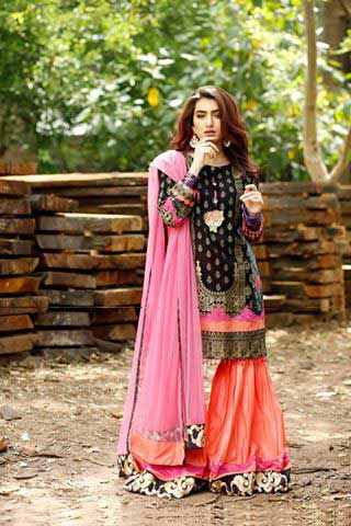 Black shirt with orange ghagra and pink dupatta by Zahra Ahmad Eid dresses for girls in Pakistan