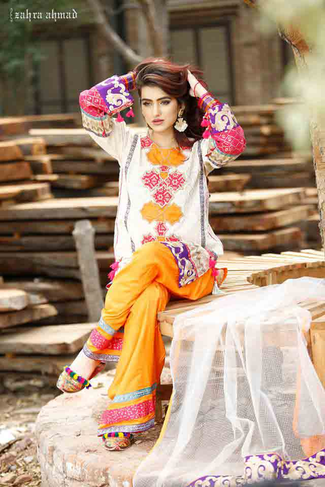 New white and yellow short shirt with matching pajama by Zahra Ahmad Eid dresses for girls in Pakistan