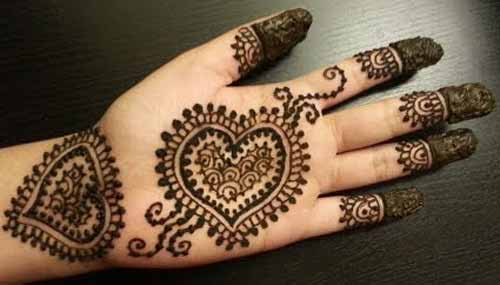 Heart front hand mehndi designs for boys hands 2017