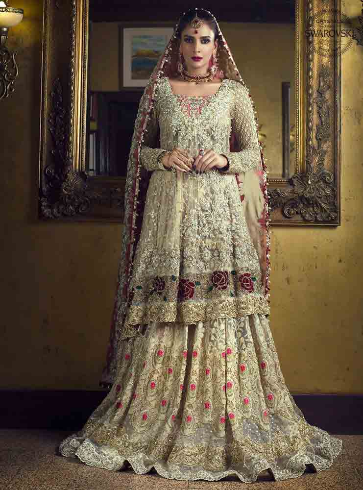 Off white and maroon bridal peplum tops with lehenga designs 2017