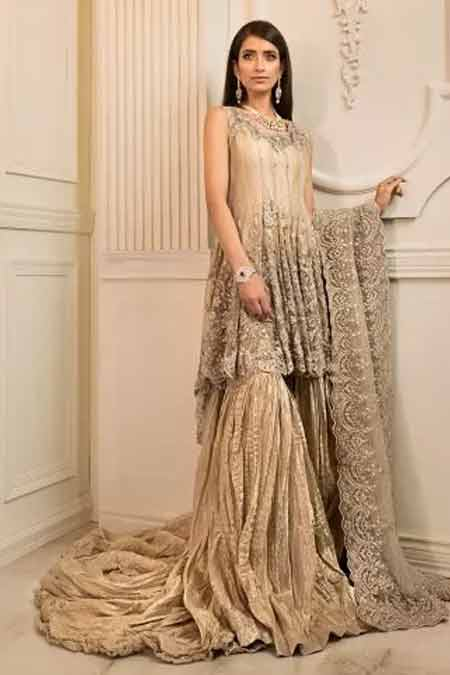 Golden or beige bridal peplum tops with lehenga designs 2017