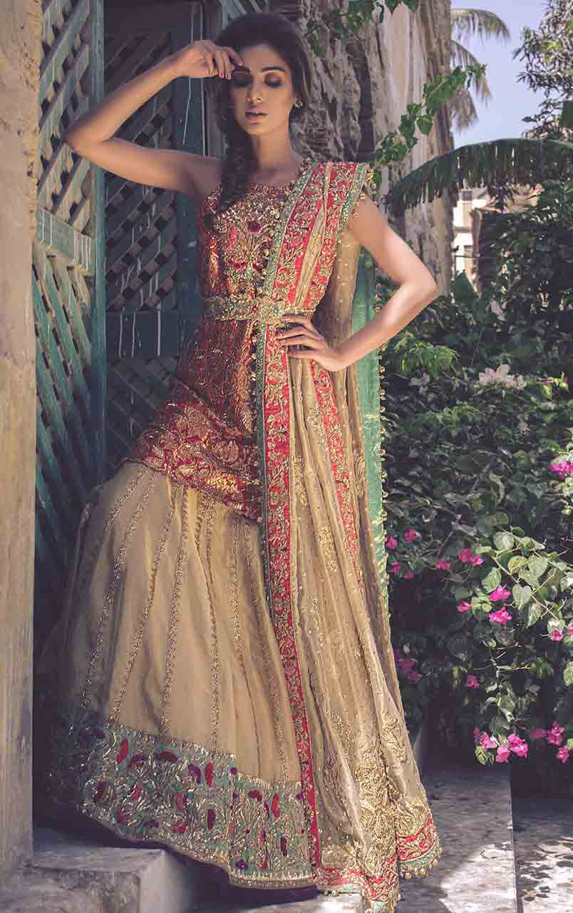 Peach and off white bridal peplum tops with lehenga designs 2017