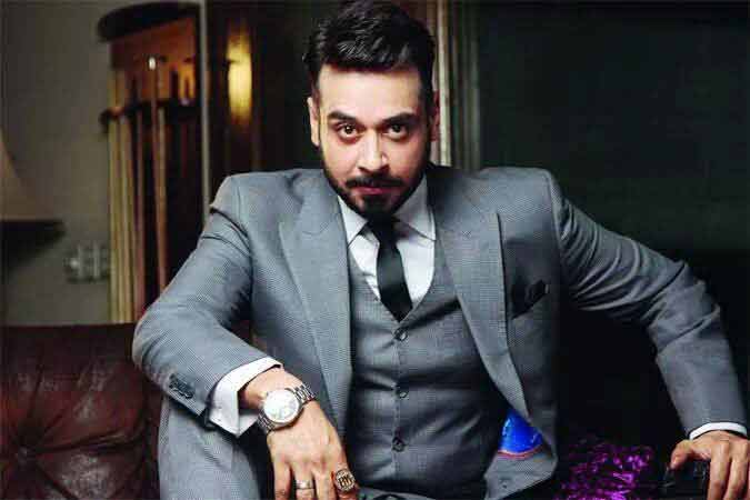 Faisal Qureshi in white shirt and black tie combinations with grey suits in Pakistan