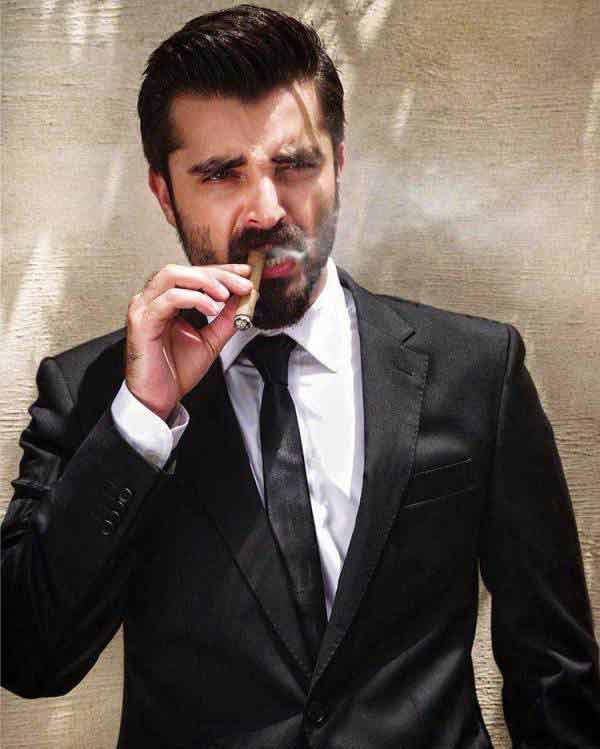 Hamza Ali Abbasi in white shirt and black tie combinations with black suits in Pakistan