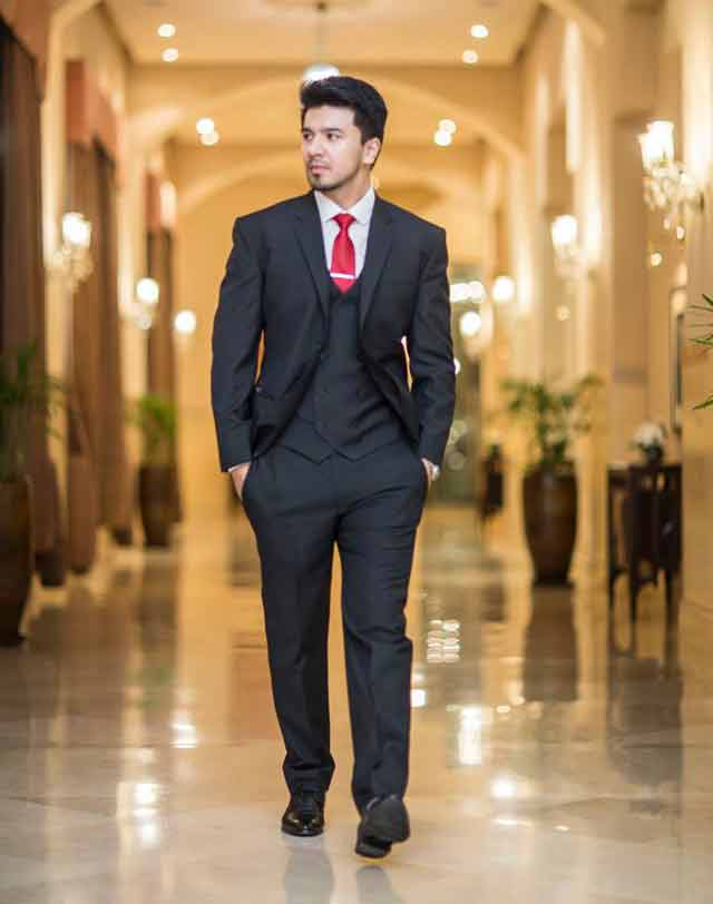 White shirt and red tie combinations with black suits in Pakistan