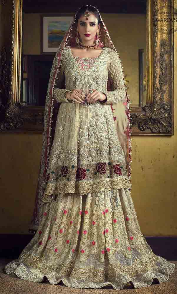 Latest design of peplum with lehenga style Pakistani bridal dress in red and golden color combinations 2018