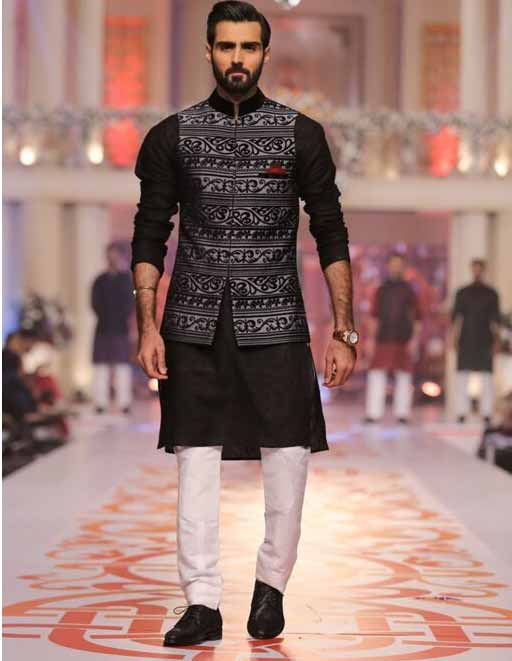 Latest black and white kurta pajama with waistcoat for grooms in Pakistan