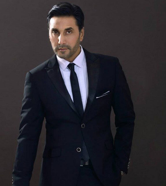 Pakistani Adnan Siddiqui in suit and necktie