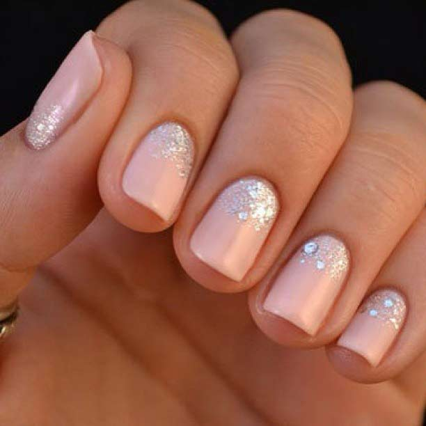 Pink nail art with glitter for Eid