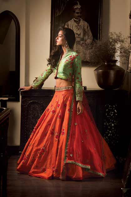Pakistani green and orange lehenga choli for pear body
