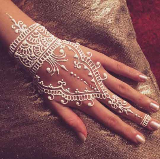 Simple white henna designs for back hand side