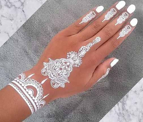 Thick white mehndi styles for back hands