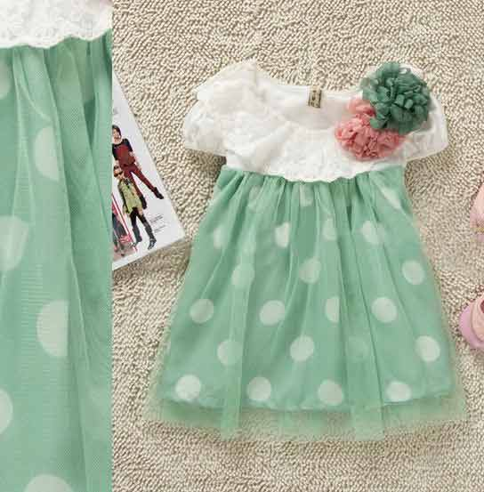White and green baby frock with flower