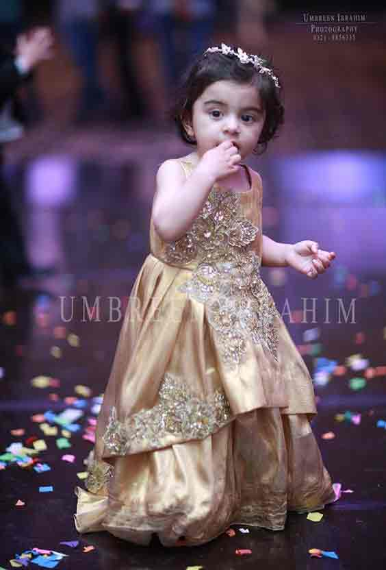 Golden baby girl princess wedding frock in Pakistan